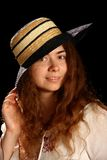 Young brunette girl and straw hat Royalty Free Stock Photography