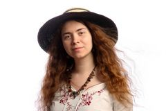 Young brunette girl and straw hat Stock Photography