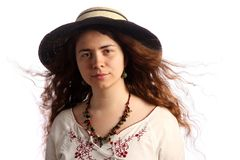 Young brunette girl and straw hat Royalty Free Stock Photo