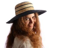Young brunette girl and straw hat Stock Image