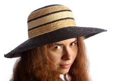 Young brunette girl and straw hat Stock Photos