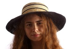 Young brunette girl and straw hat Royalty Free Stock Images