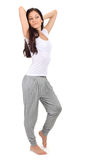 Young brunette girl stretching after awaking. Young beautiful brunette girl stretching after awaking, isolated on white royalty free stock image