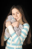 Young brunette girl with teddy bear. Beautiful young brunette girl with teddy bear Stock Photo