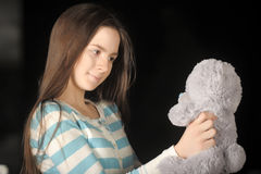 Young brunette girl with teddy bear. Beautiful young brunette girl with teddy bear Royalty Free Stock Photos