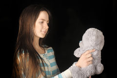 Young brunette girl with teddy bear. Beautiful young brunette girl with teddy bear Royalty Free Stock Images