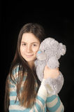 Young brunette girl with teddy bear. Beautiful young brunette girl with teddy bear Royalty Free Stock Image
