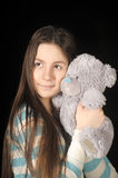 Young brunette girl with teddy bear. Beautiful young brunette girl with teddy bear Royalty Free Stock Photo