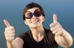 Young brunette girl thumbs up Royalty Free Stock Images