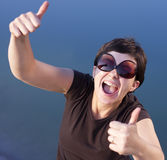Young brunette girl thumbs up Royalty Free Stock Image