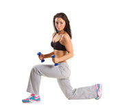 Young  girl  training with dumbbels Stock Photo