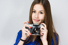 Young brunette girl using camera. Stock Photography