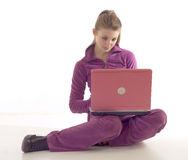 Young brunette girl using laptop Royalty Free Stock Photo