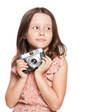 Young brunette girl with vintage camera. Stock Photography