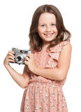 Young brunette girl with vintage camera. Stock Image