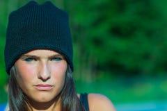Young brunette girl with woolen cap stock photos