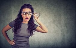 Amazed woman listening to rumors royalty free stock photography