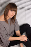 Young brunette in a gray dress Stock Images