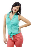 Young brunette with a green shirt and pink pants stock photo