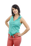 Young brunette with a green shirt and pink pants stock images