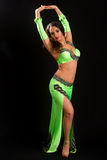 Young brunette in a green suit oriental dance