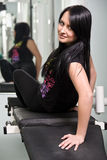 Young brunette in gym Stock Image