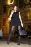 Young brunette with handbag Stock Photo