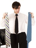Young brunette handsome guy having choice between two ties isolated on white background, lifestyle business people Stock Image