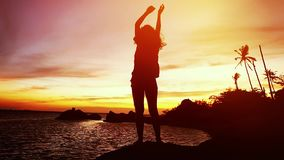 Silhouette of young happy woman dances at beautiful sunset. slow motion. 1920x1080. Young brunette happy woman have fun dances at beautiful sunset. slow motion stock footage