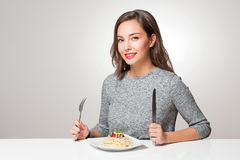 Young brunette having Italian food. Royalty Free Stock Images