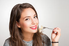 Young brunette having Italian food. Royalty Free Stock Image