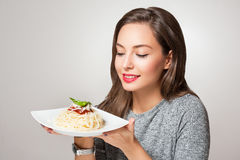 Young brunette having Italian food. Royalty Free Stock Photo