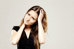 Young brunette with a headache Royalty Free Stock Image