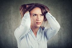 Stressed young woman squeezing head stock photos