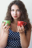 Young brunette holding two cups Royalty Free Stock Photos