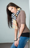 Young brunette jeans model outdoors. Stock Photography