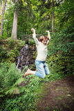 Young brunette is jumping in the park Royalty Free Stock Photo