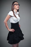 Young brunette lady in black dress posing Royalty Free Stock Image
