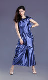 Young brunette lady in blue dress posing Stock Photo