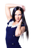 Young brunette lady in blue dress posing Royalty Free Stock Photo