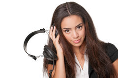Young brunette lady listening to headphones, on white Stock Image