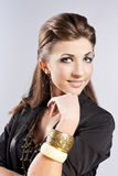 Young brunette lady with luxury accessories Royalty Free Stock Photo