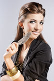 Young brunette lady with luxury accessories Stock Photography