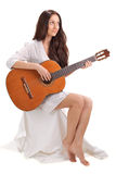 Young Brunette Lady Playing Acoustic Guitar Royalty Free Stock Photography