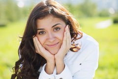 Young brunette leaning on hands Royalty Free Stock Photography