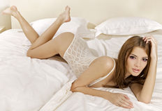 Young brunette in lingerie Stock Images