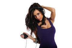 Young Brunette listening to music Stock Photos