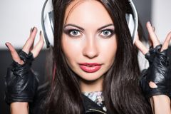 Young brunette listening to music royalty free stock photos