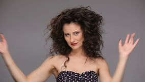 Young brunette with long brown curly hair dancing stock video