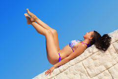 Young brunette lying Royalty Free Stock Photos